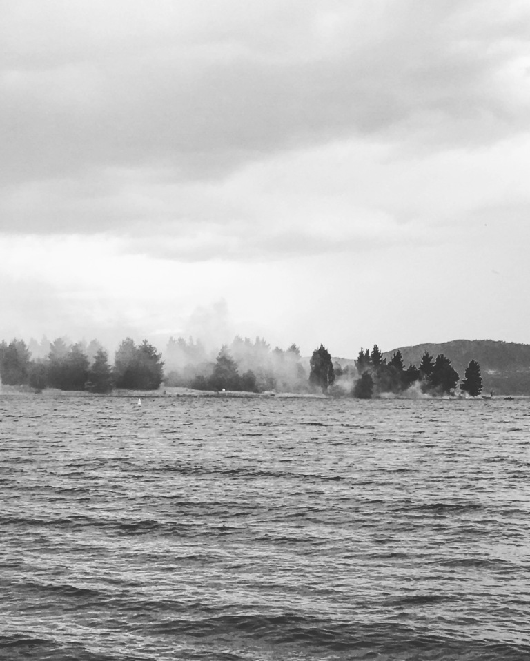 Lake Jindabyne in a storm with Lion Island on fire!